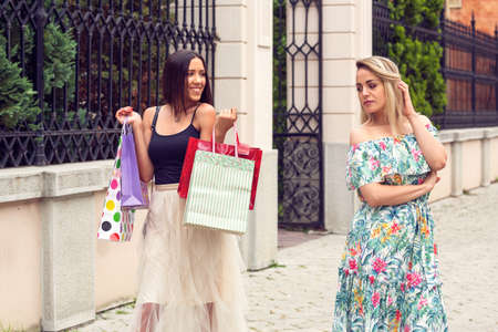 two young woman arguing at shopping in the city.