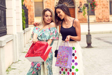 Shopping fun. – Happy girls with shopping bags in the city.
