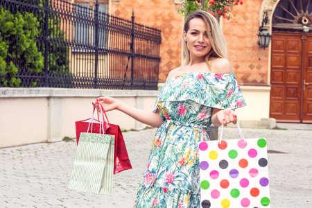 Beautiful shopping woman happy holding shopping bags.