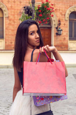 Shopping with a smile. young woman with shopping bags