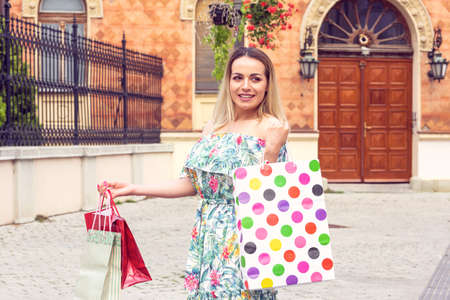 Shopping gift and present on holiday. Beautiful women holding a shopping bag.