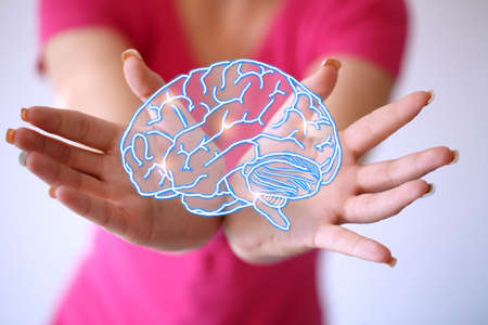 Use brain - Mind Energy -Woman hand shows the neurons in brain.