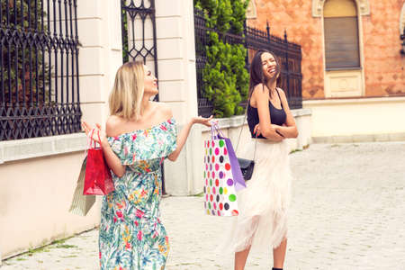 girl with shopping bags, concept of discounts and shopping, Jealous young woman shopping and arguing Standard-Bild