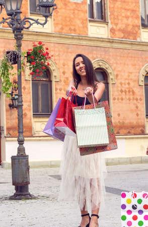 Shopping - young woman with shopping bags. shopping in black Friday. Women Shopping.