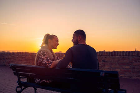 Smiling Couple in Love at evening enjoying time together.