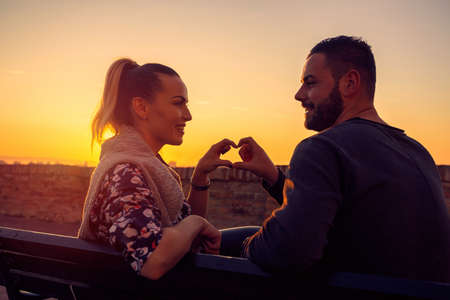 Heart and love.Happy Couple in Love at evening enjoying time together.