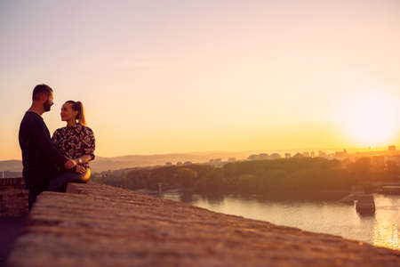 Smiling young  couple spend time together at sunset