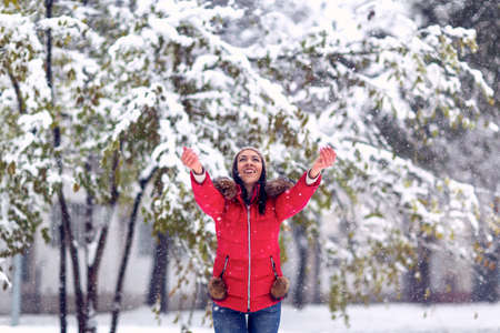 Winter holiday and people concept -Happy Girl enjoying in the snow