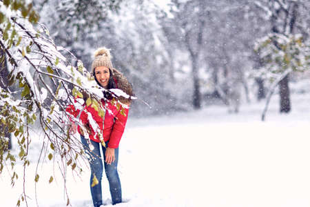 Smiling woman in magic winter day.Young woman enjoying the snowy day.
