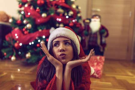 Happy funny girl Santa hats on Christmas celebrating Christmas  at home