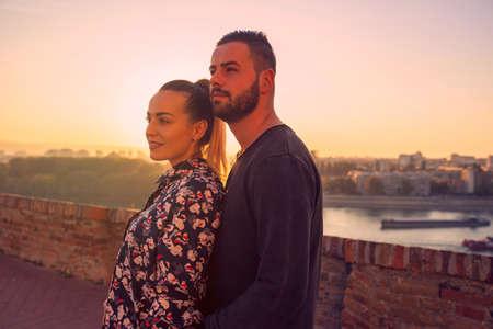 Young romantic couple enjoys at the sunset Standard-Bild