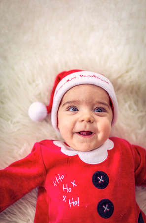 Smiling Baby boy  in santa claus costume.Cute Santa claus Baby boy on Christmas day