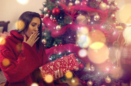 Woman at Christmas.Happy Girl and Christmas Present.