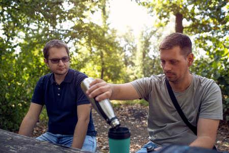 Men enjoying peaceful sunny day in nature