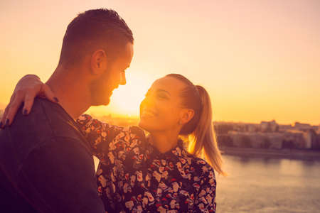 Young smiling woman enjoying in  love at sunset Standard-Bild