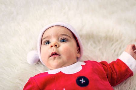 Baby boy  in santa claus costume.Little cute baby boy with christmas clothes, Standard-Bild