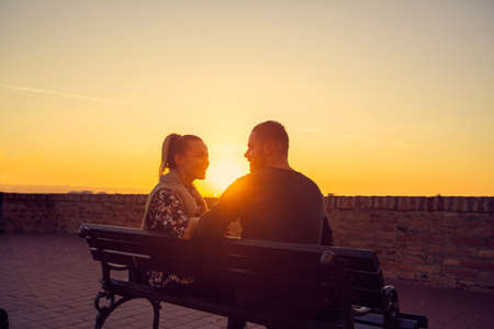 Loving young man and woman enjoying together at evening