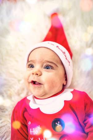 Cute baby boy wearing santa clothes.Smiling Baby boy  in santa claus costume Standard-Bild