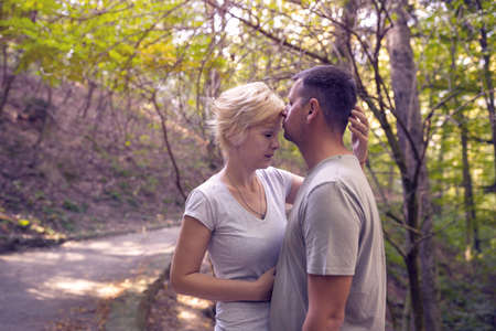 Romantic beautiful couple. lovers in the forest. love you every day