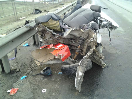 The car of a mad street racer tore apart. Metal back crumpled like a piece of paper.