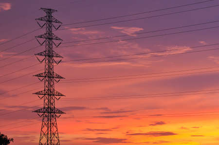 Electrical tower with colorful sky
