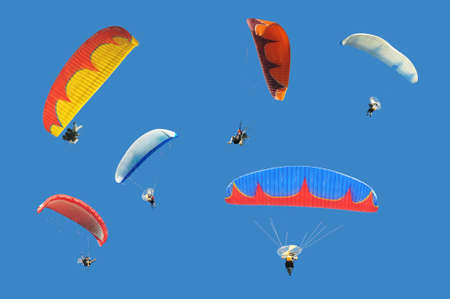 Colorful paramotor on blue sky photo