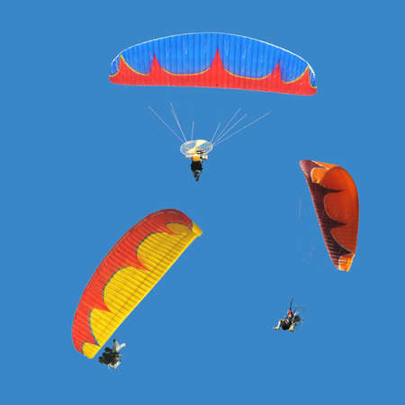 Group of colorful paramotor with fire texture on wing Stock Photo