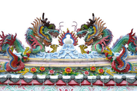 Dragon statue on roof of chinese temple photo