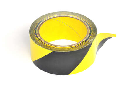 Yellow caution tape on white background photo