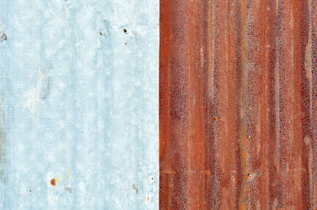 Rusty and normal zinc metal plate background Stock Photo - 9591675