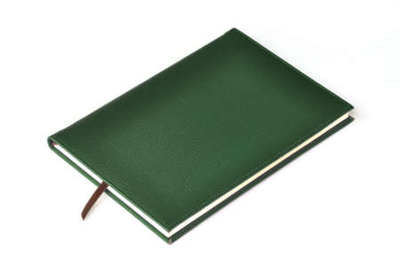 Dark green leather notebook on white background photo