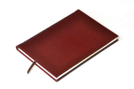 Dark red leather notebook on white background Stock Photo