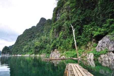 Bamboo raft heading on lake in Kho Sok national park, Thailand