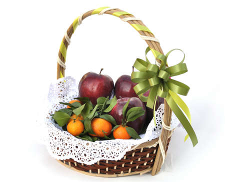 Fruit basket decorated with green ribbon for gift photo