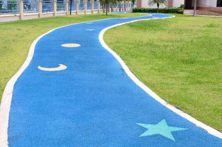 Cute jogging lane in park Stock Photo