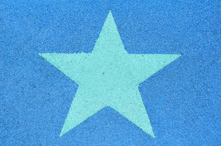 Green star label decorated on jogging lane photo
