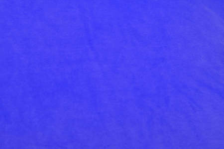 Bright blue velvet fabric background photo
