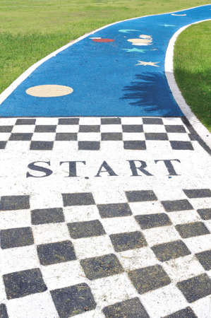 Start label on cute jogging lane in garden
