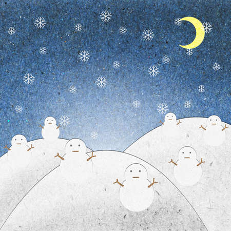 Snow field night with snowman recycle paper craft for background Stock Photo
