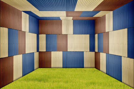 Metal sheet room and grass field Stock Photo