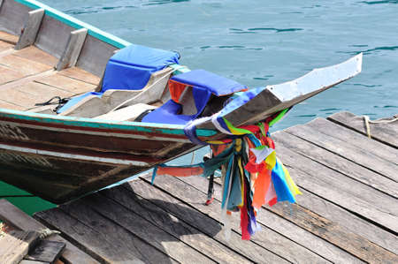 Head of long tailed boat decorated with colorful cloth