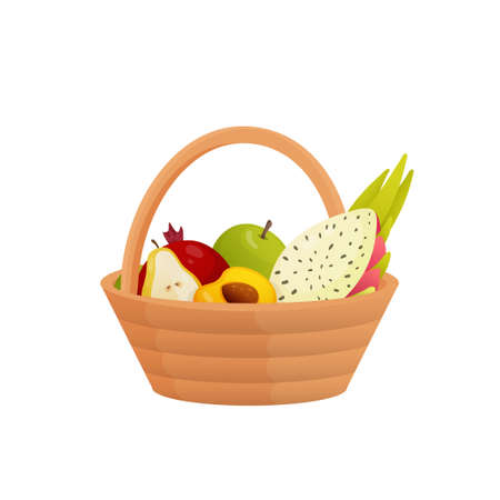 Wicker fruit basket with a comfortable handle. Pottle filled with one pomegranate and apple, slicedpear, apricot, pitahaya, apricot. Healthy food concept. Picnic theme