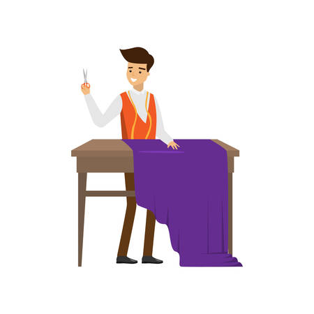 Male tailor standing at table with scissors in hand ready cut purple cloth