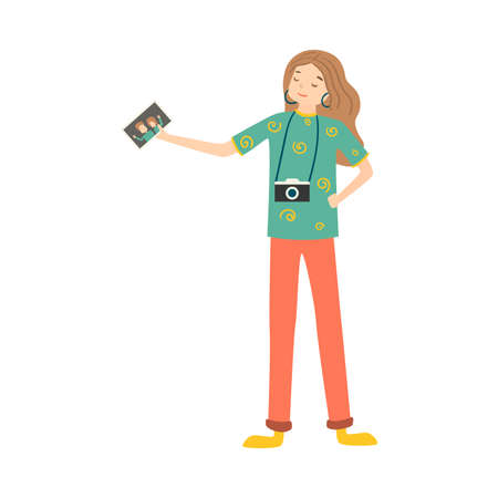 Girl with photo camera standing and holding photo illustration