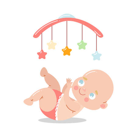 Cute happy baby in red underpants lying in bed and having fun with toy carousel.