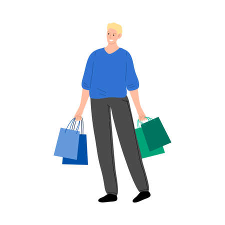 Young man carrying shopping bags during sales