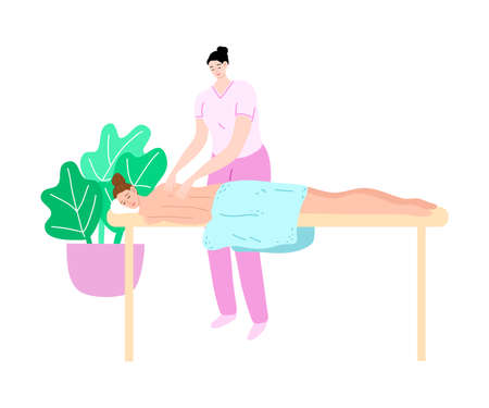 Woman lying on masseurs table for spa procedures in beauty saloon