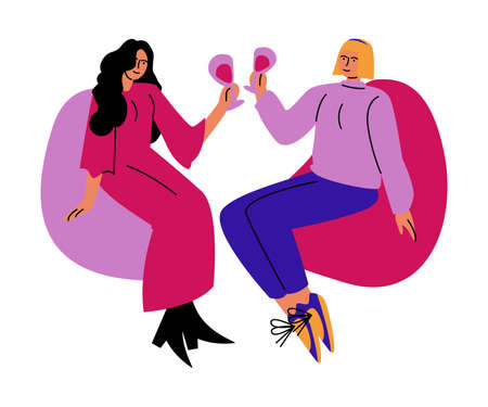 A happy lesbian couple of women drinks wine from glasses sitting on chairs. Vector illustration in cartoon style.