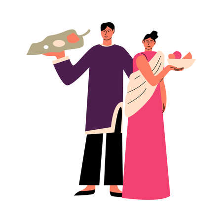 Indian man and woman in traditional clothing holding plates with food at holiday