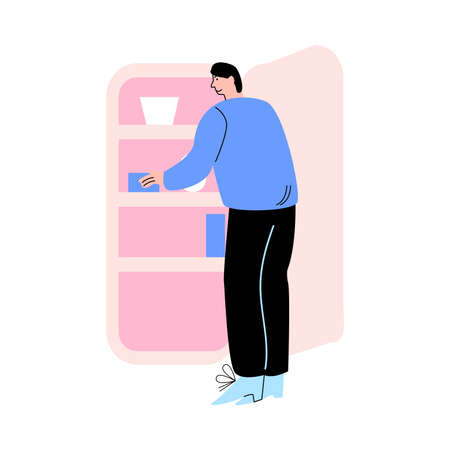 Man standing backwards and putting food to fridge at home during weekday